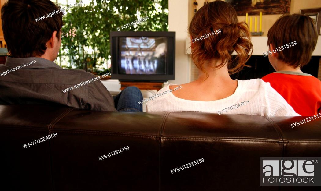 Stock Photo: Couple watching television with young boy.