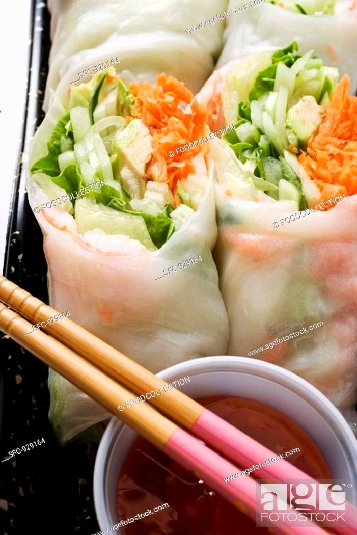 Stock Photo: Vietnamese spring rolls with chili sauce to take away.