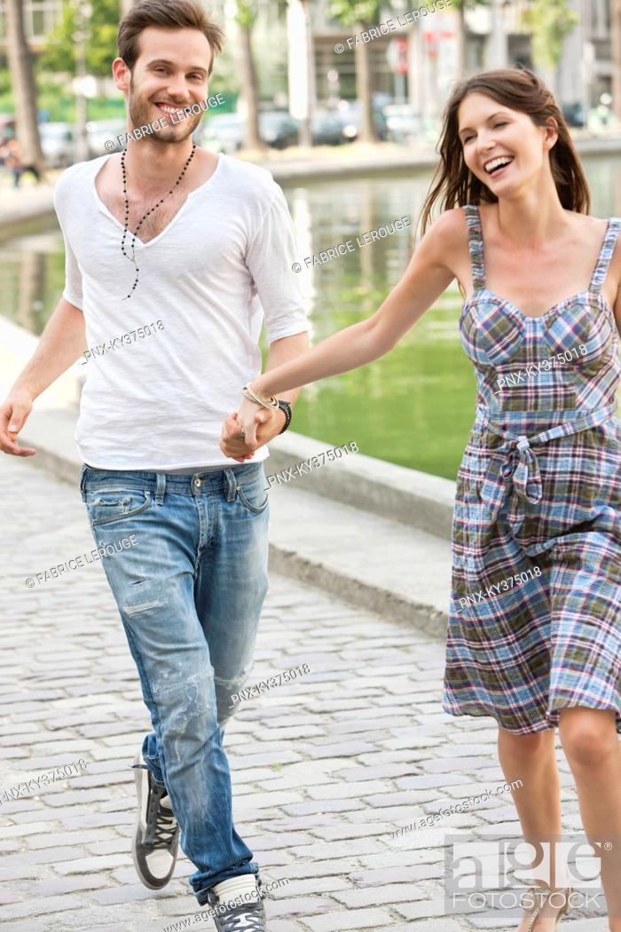 Stock Photo: Couple enjoying near a canal, Paris, Ile-de-France, France.