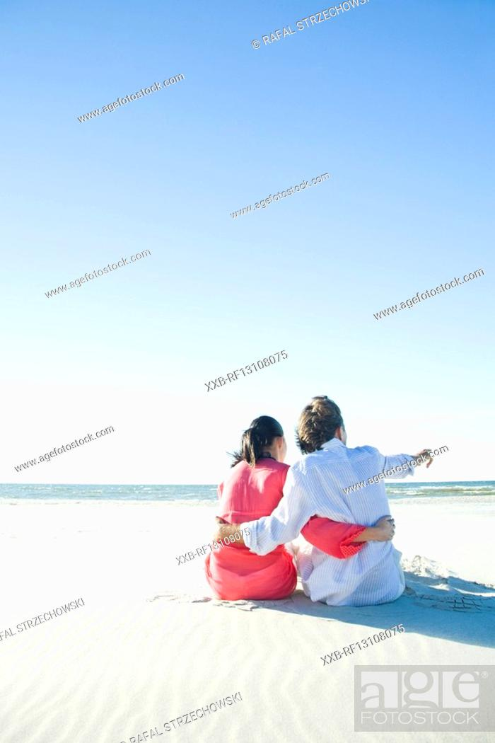 Stock Photo: couple relaxing on beach.