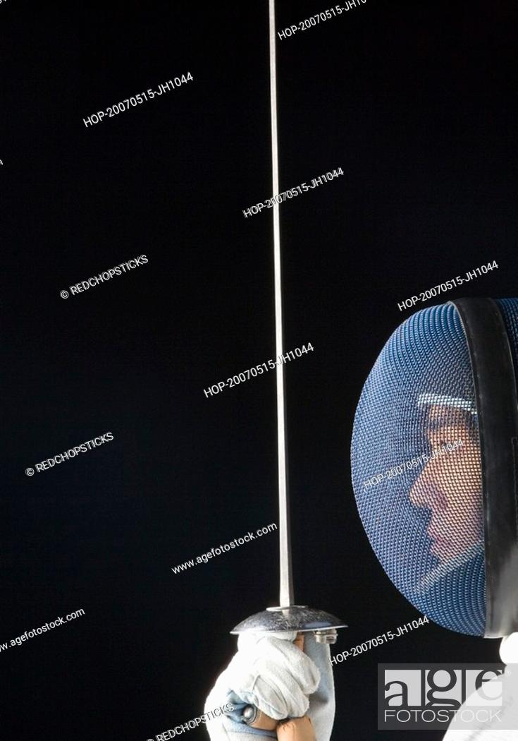 Stock Photo: Close-up of a male fencer holding a fencing foil.