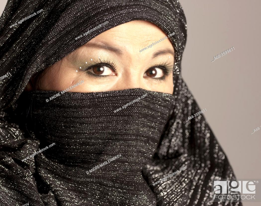 Stock Photo: Women portrait with covered face arabic style. Photo: André Maslennikov.