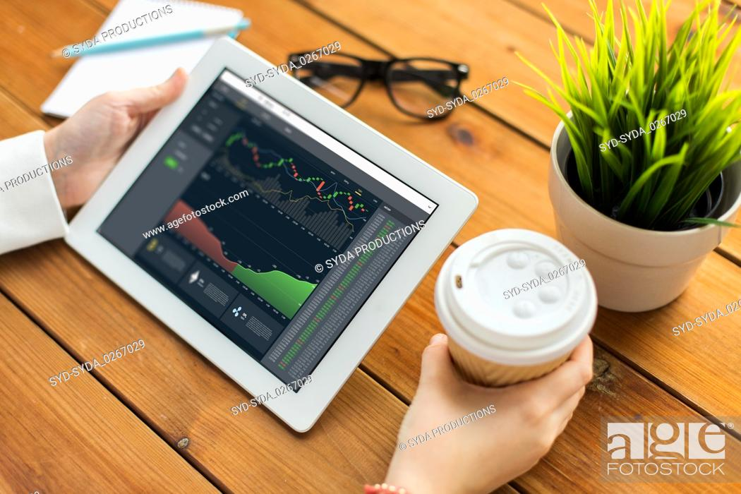 Stock Photo: hands with cryptocurrency on tablet pc screen.