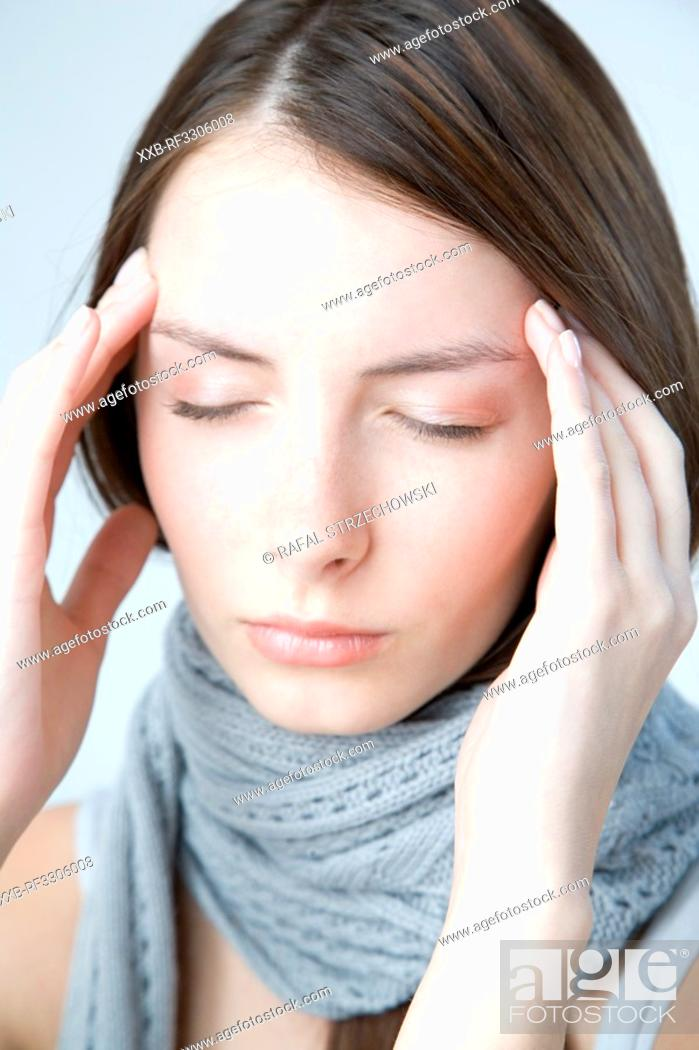 Stock Photo: young woman with headache.