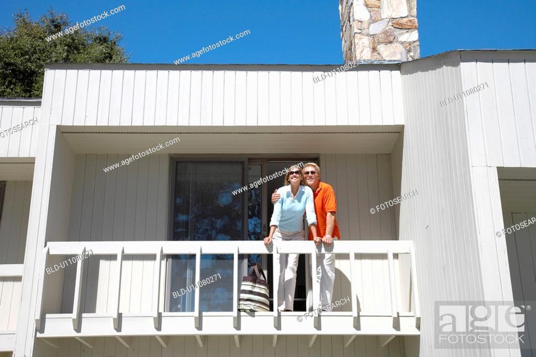 Stock Photo: Couple standing on balcony.