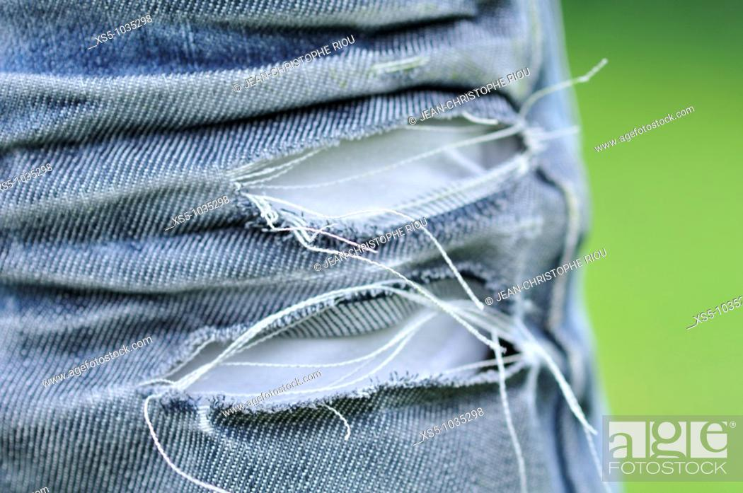 Stock Photo: used jeans.