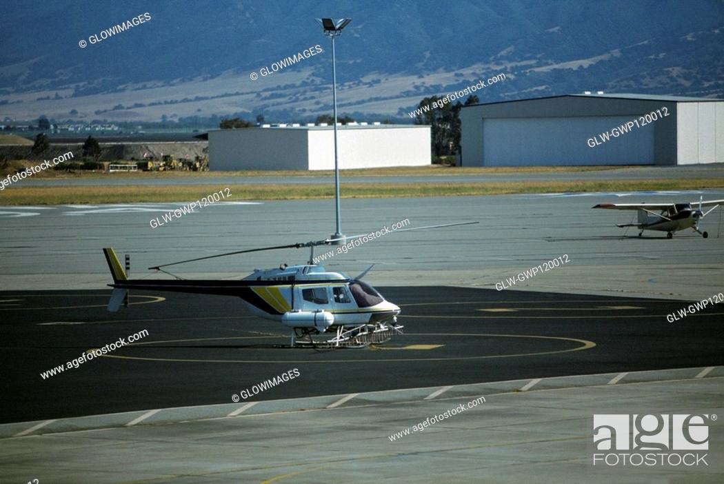 Stock Photo: Helicopter rigged for aerial irrigation.
