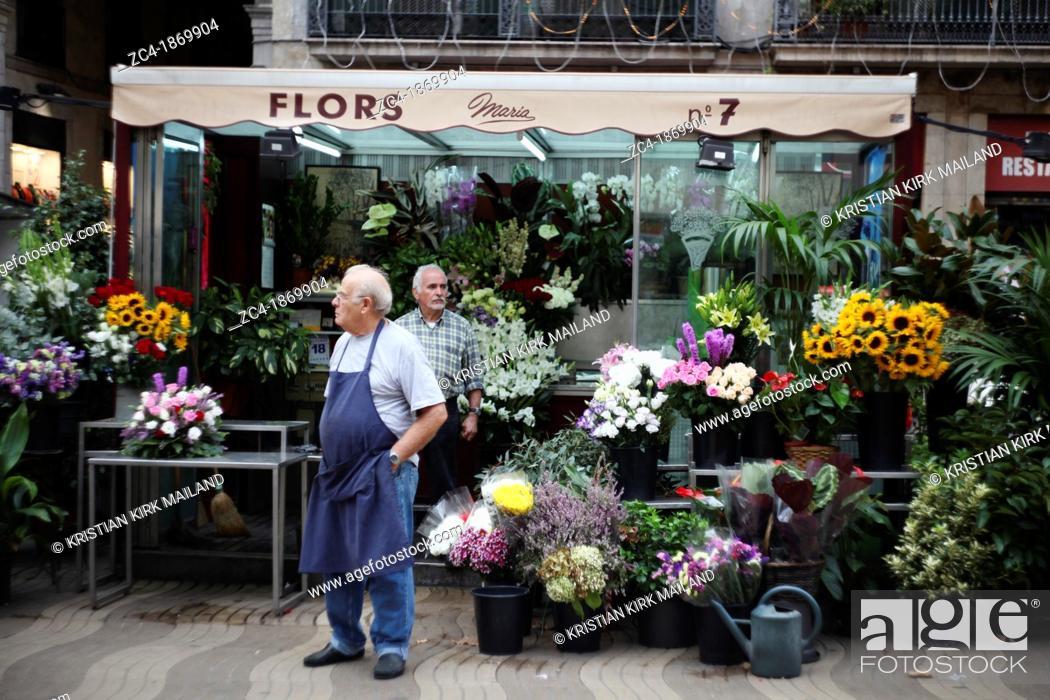 Stock Photo: Flourist selling flowers at la Rambla, Catalonia, Spain.