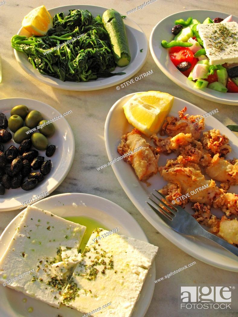 Stock Photo: Greek Cuisine  Feta, Kalamari, Olives, Salad and Vleeta Stamnagathi Wild Greens.