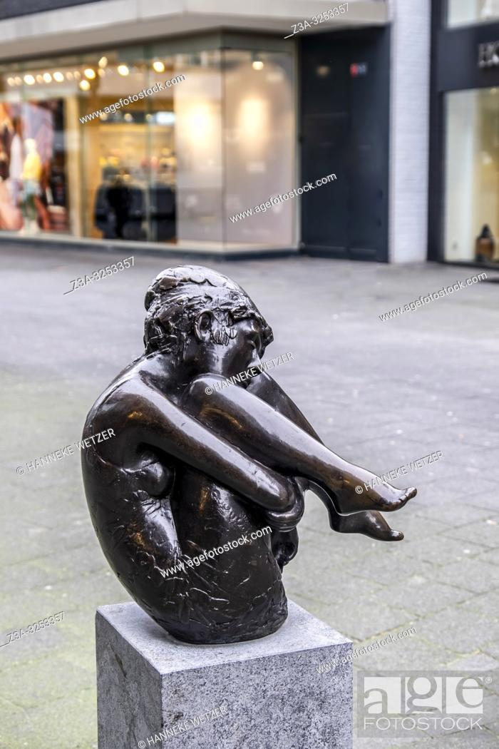 Stock Photo: Statue of a young girl balancing in Rotterdam, The Netherlands, Europe.