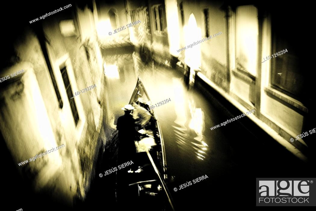 Stock Photo: Gondolier in the canal, Venice, Italy.