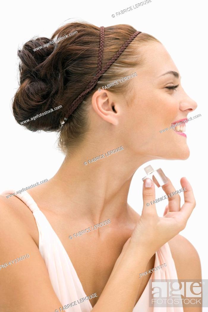 Stock Photo: Fashion model applying perfume.
