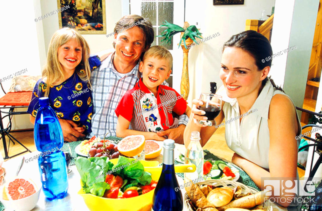 Stock Photo: Portrait of a family at a dinner table.