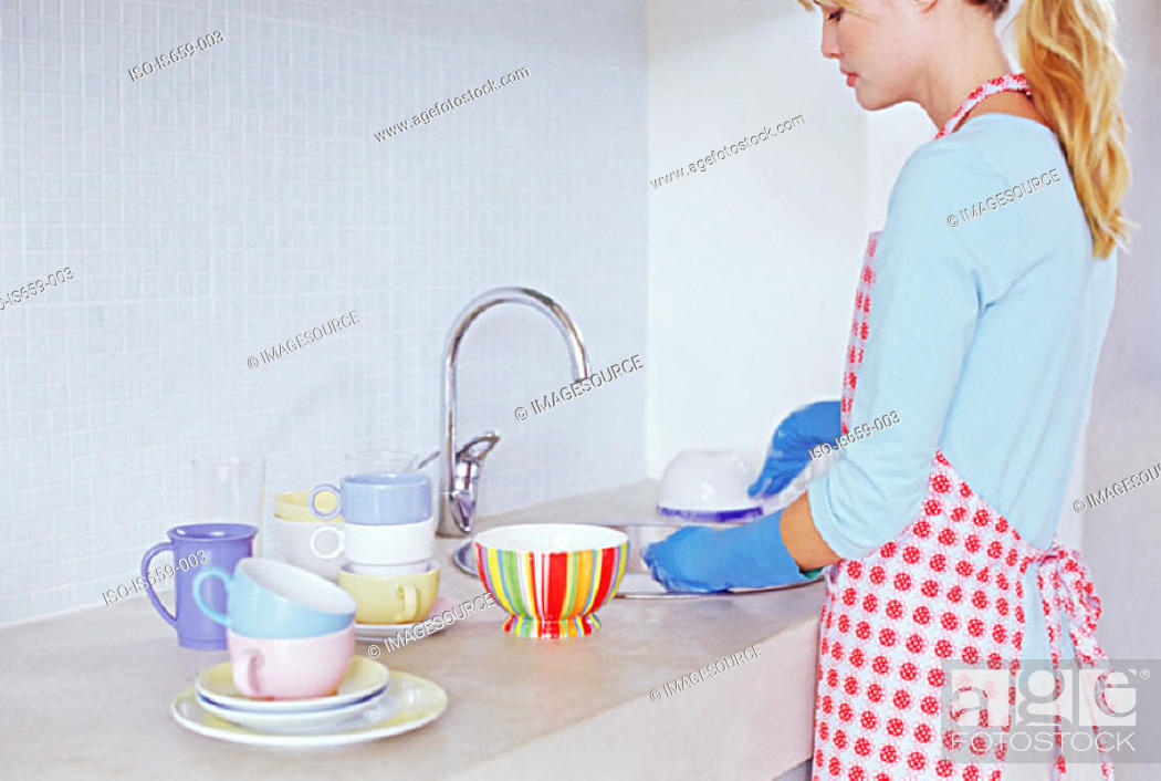 Stock Photo: Woman washing up.