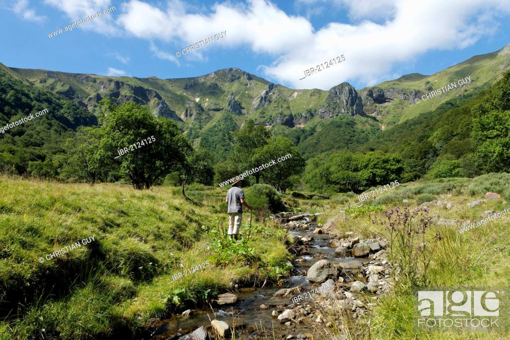 Stock Photo: Hiker in Chaudefour Valley natural reserve, Parc Naturel Regional des Volcans d'Auvergne, Auvergne Volcanoes Regional Nature Park, Puy de Dome, France, Europe.