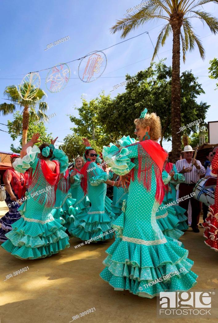 Stock Photo: Women wearing gypsy dresses perform traditional Andalusian dances at the Feria del Caballo, Jerez de la Frontera, Cádiz province, Andalusia, Spain.