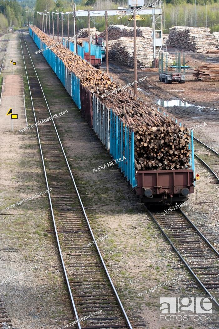 Stock Photo: Timber loading in railroad box cars, Finland.