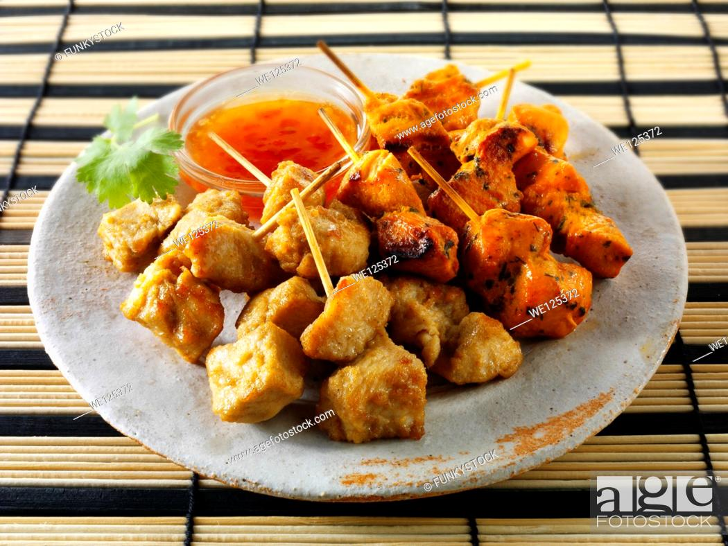 Stock Photo: Traditional oriental satay with chilli dipping sauce.