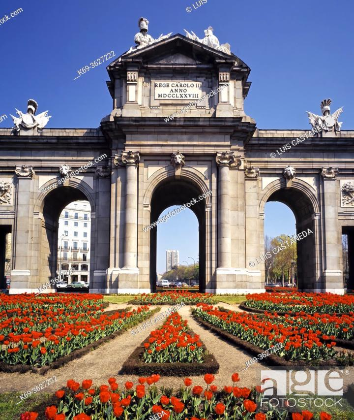 """Stock Photo: The Puerta de Alcalá (""""""""Alcalá Gate"""""""") is a Neo-classical monument in the Plaza de la Independencia (""""""""Independence Square"""""""") in Madrid, Spain."""