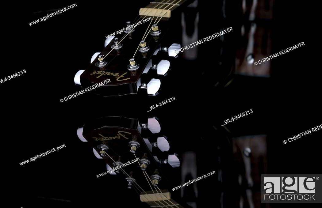 Stock Photo: Close up image form a classic guitar on a mirror as background painted with light.