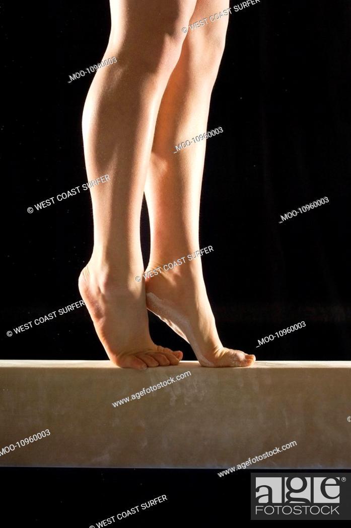 Stock Photo: Gymnast 13-15 on balance beam low section.