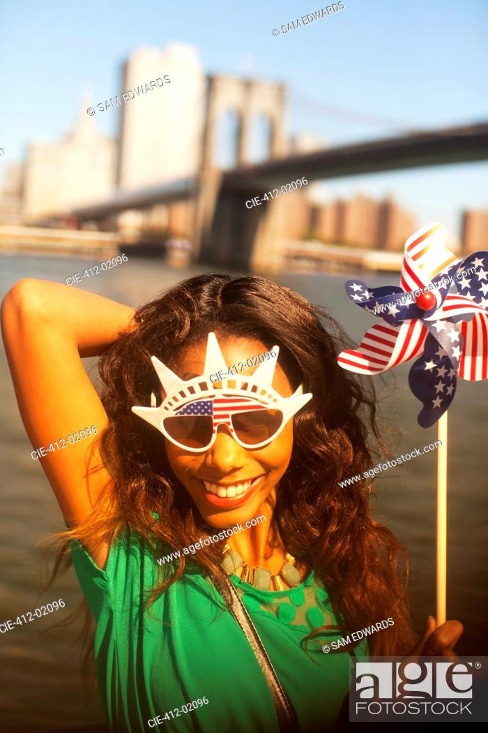 Stock Photo: Woman with novelty sunglasses.