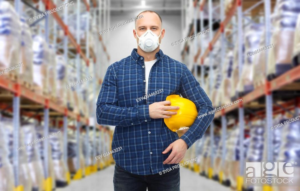 Stock Photo: male worker wearing respirator mask at warehouse.