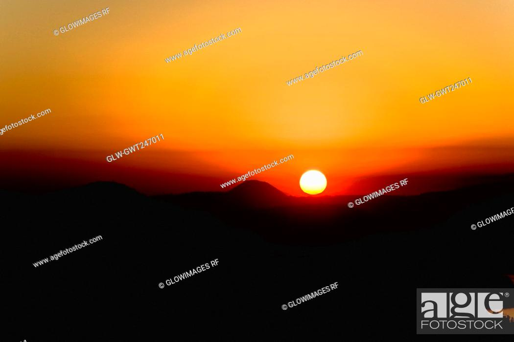 Stock Photo: Sunset over a mountain range, Janitzio Island, Lake Patzcuaro, Morelia, Michoacan State, Mexico.