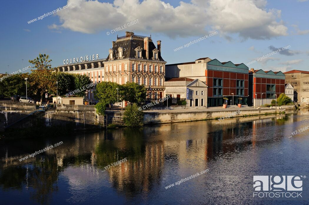Stock Photo: The cognac house of Courvoisier is established on the banks of the Charente river in the town of Jarnac, Charente, France.