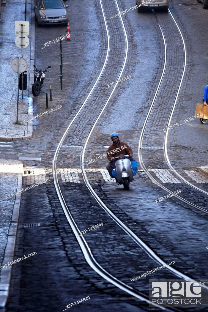Stock Photo: A motorcycle in the central streets of Baixa, Lisbon.