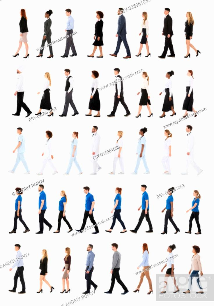 Stock Photo: Multiracial Businesspeople Walking In Row Against White Background.