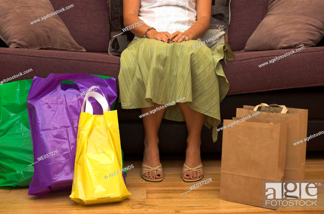 Stock Photo: Woman rests after a hard day shopping.