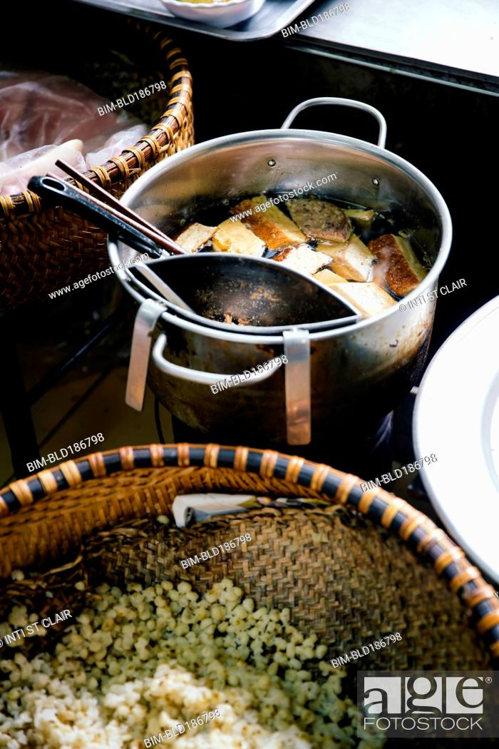 Photo de stock: High angle view of pots of soup and rice.