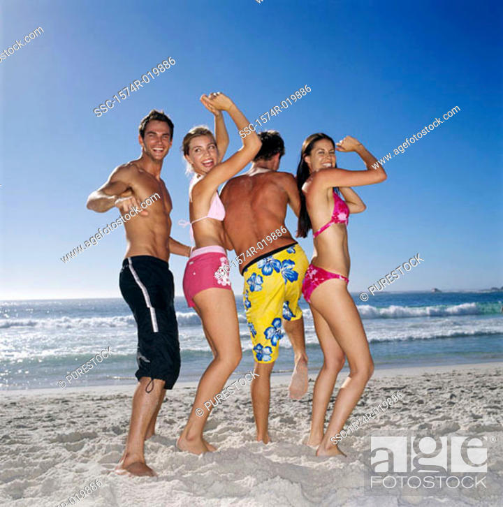Stock Photo: Two young couples dancing on the beach.