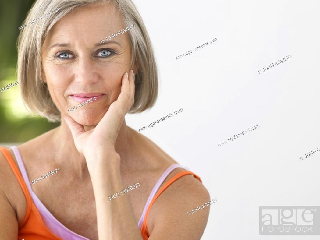 Stock Photo: Woman on verandah portrait.