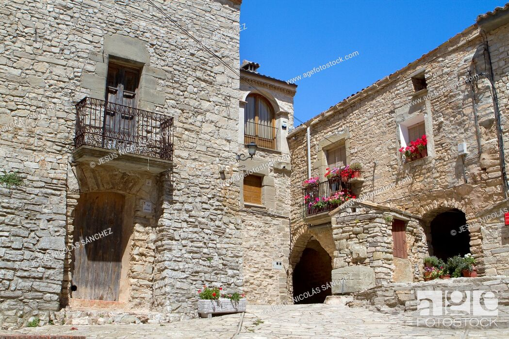 Stock Photo: Square of Montfalcó Murallat, a extremly small medieval and fortified village. Segarra. Lleida province. Spain.