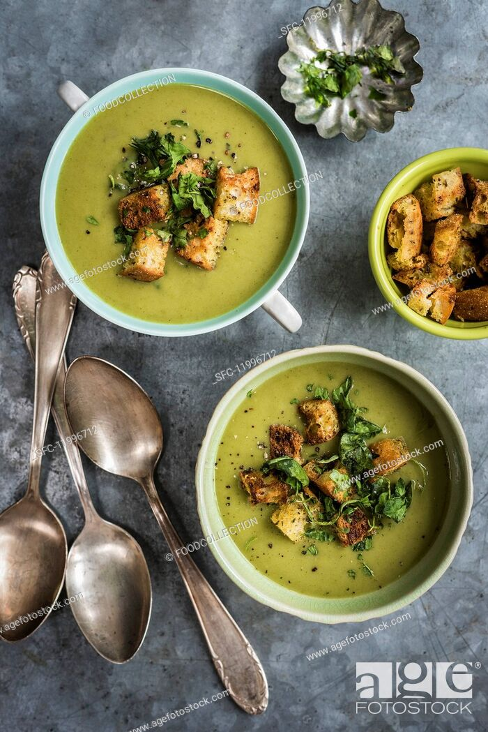 Stock Photo: Vegan spinach, leek, courgette & coconut milk soup with spicy croutons.