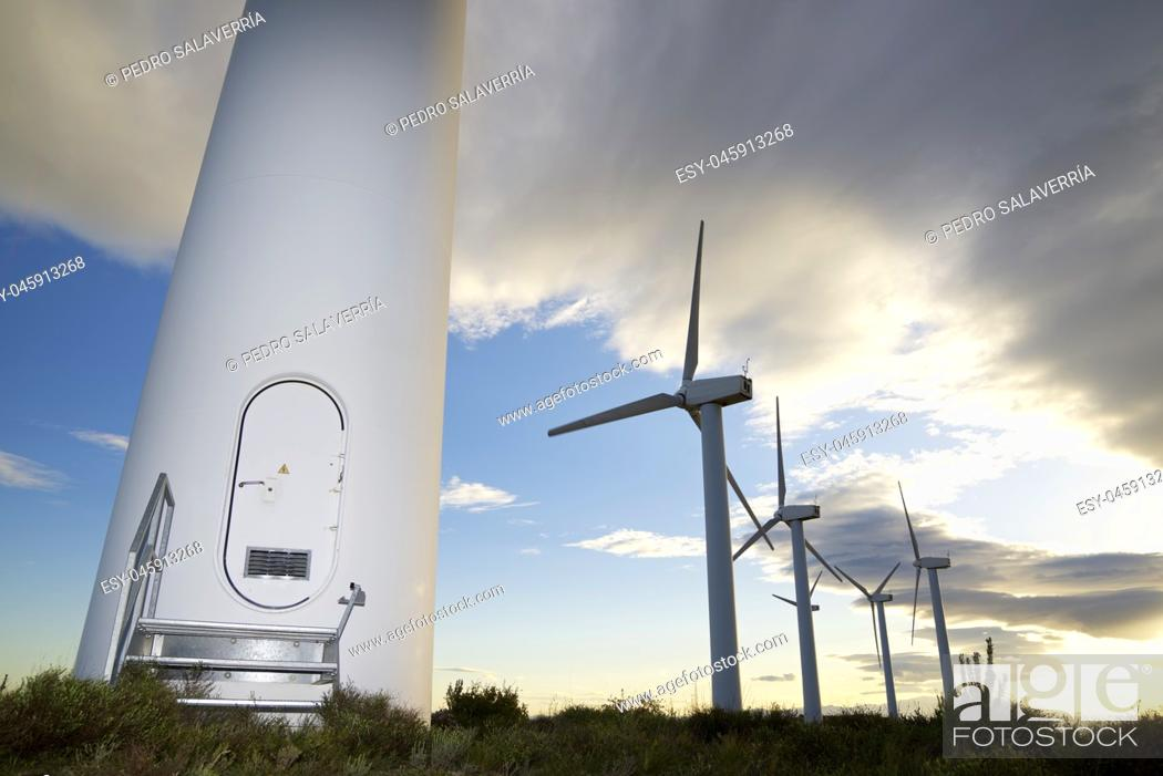 Photo de stock: Windmills for electric power production at sunset, Zaragoza Province, Aragon, Spain.