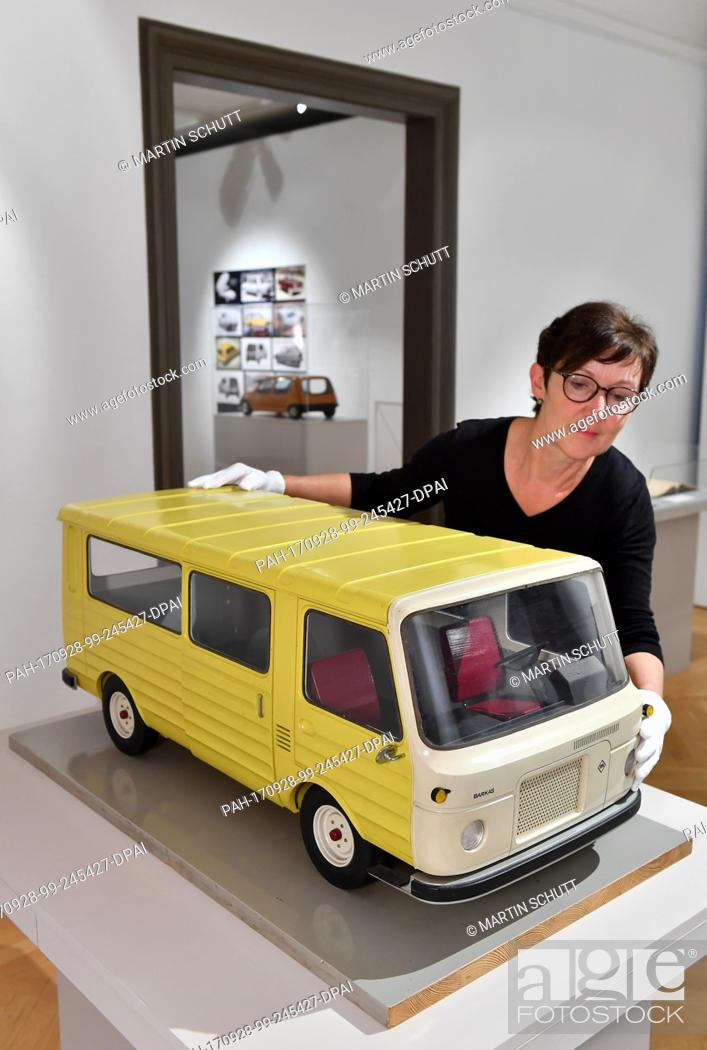 Stock Photo: Curator Doris Weilandt stands next to a model of the Barkas 1100 from 1968 at the exhibition 'Barkas, Simson, Moccadolly - Lutz Rudolph (1936-2011)Fahrzeug-.