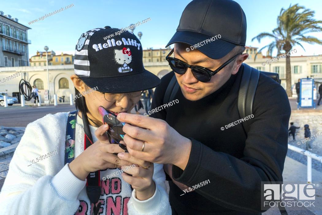 Stock Photo: Nice, France, Chinese Tourists visiting Promenade des Anglais, Near Mediterranean Sea Beach.