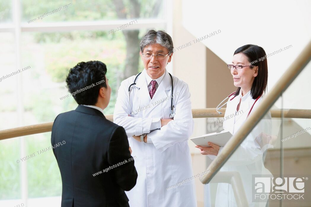 Stock Photo: Japanese doctors talking with salesman.