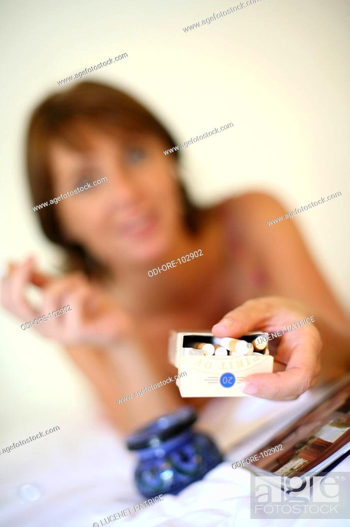 Stock Photo: Woman tobacco.