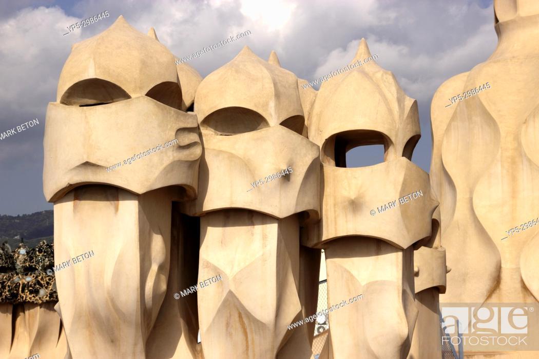 Stock Photo: Sculpted chimneys on rooftop of La Pedrera, Barcelona, Spain.