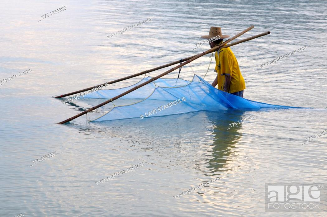 Stock Photo: fisherman at dawn in Khao Sam Roi Yot National Park in Thailand.