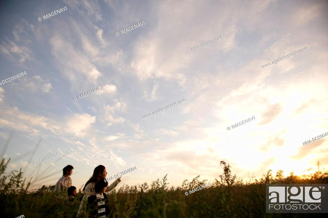 Stock Photo: A family in the field of grass.