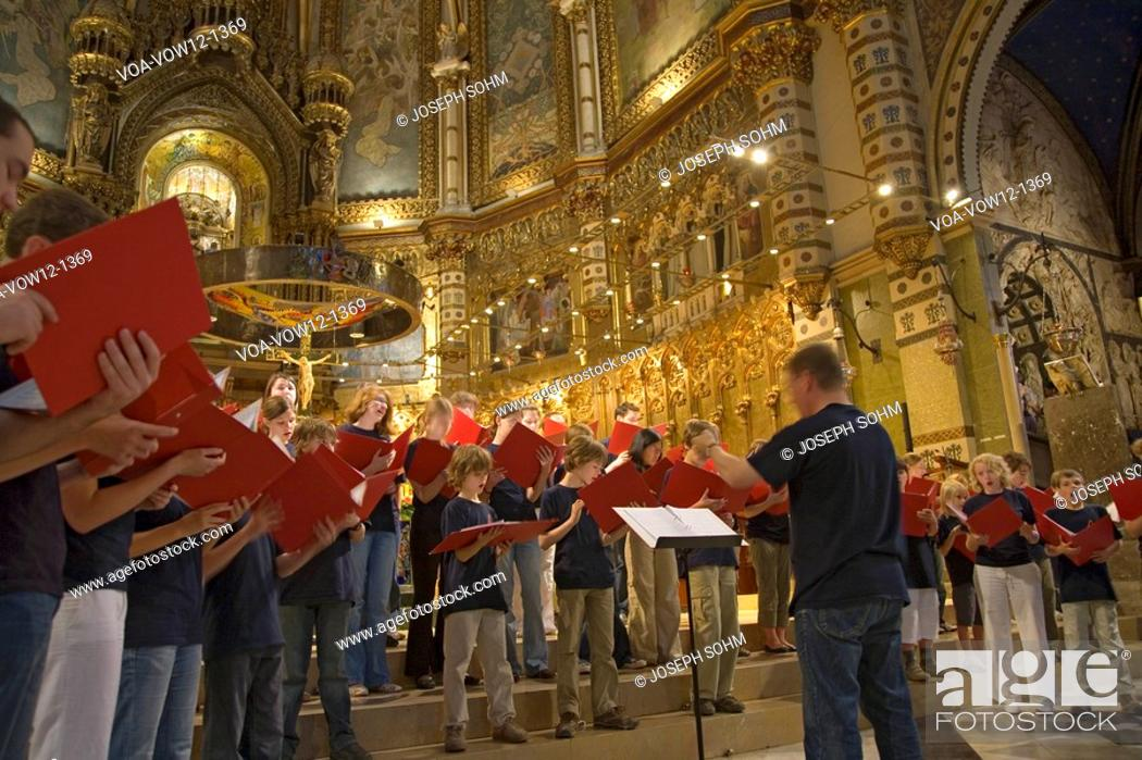 Stock Photo: Boys & girls choir singing in the Benedictine Abbey at Montserrat, Santa Maria de Montserrat, near Barcelona, Catalonia, Spain with Black Madonna in background.