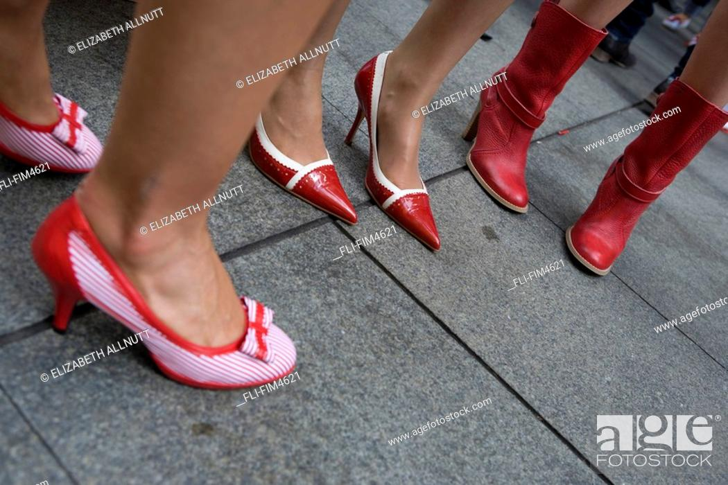 Stock Photo: Close Up of Women Standing in Red Shoes.