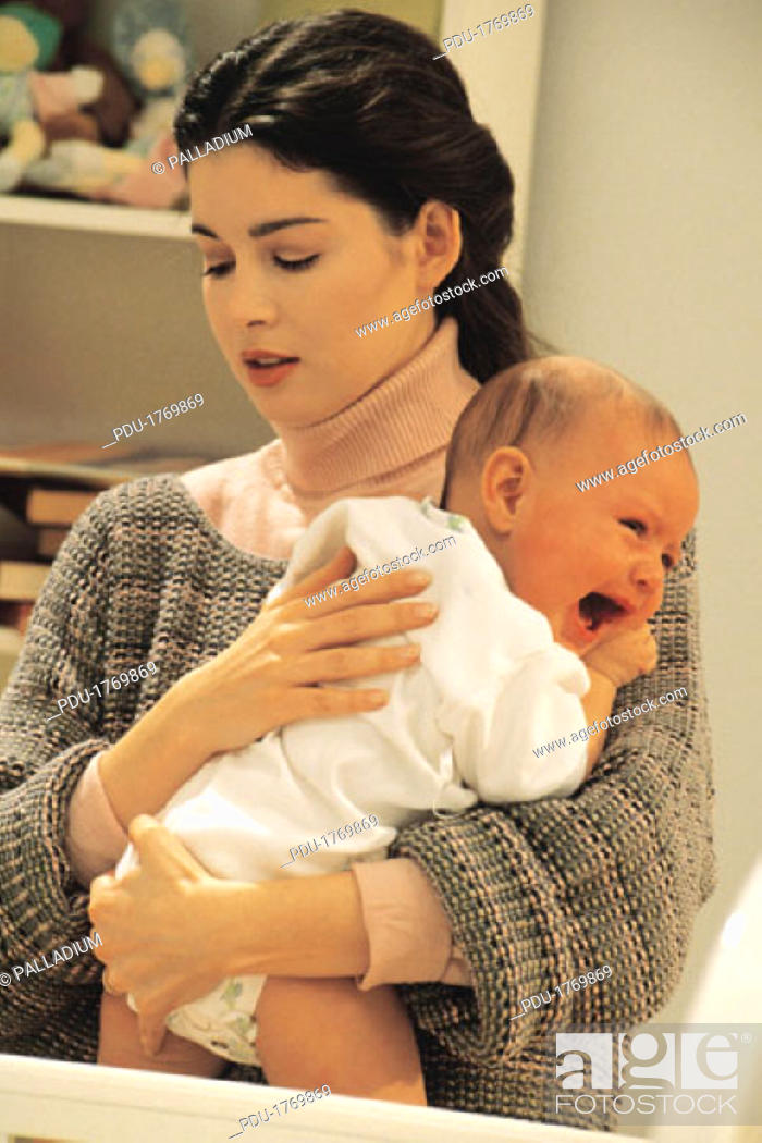 Stock Photo: Mother comforting a crying baby.