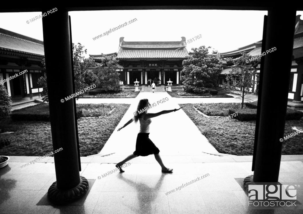 Stock Photo: Woman in Giant Wild Goose Pagoda. Xian. China.