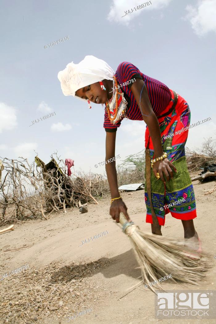 Stock Photo: Ethiopian girl at work.